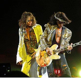 Steven Tyler - Steven Tyler (left) and Joe Perry (right) performing at the Nassau Coliseum on July 1, 2012