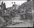 Photograph of Ernie Pyle Resting with the Marines - DPLA - 6385a56a4e18a115802bdf0e5c67c1a3.jpg
