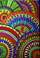 Photograph of colored Mandalas Superimposed on top of one another in blues reds greens.jpg