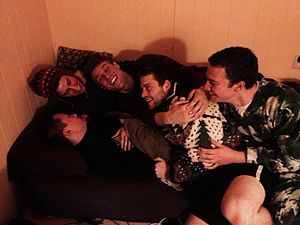 Physical intimacy - Young men engage in cuddling, a form of physical intimacy