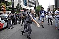 Police officer trying to hit a protester, São Paulo, 2015 (Sequence 6).jpg