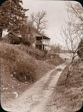 Port Royal, Virginia - Port Royal house. Photo shows dirt road leading to river; on left, house with stone 1st floor and wood 2nd floor. By Frances Benjamin Johnston, between 1927 and 1929