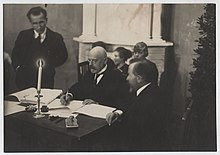Poska signing the Treaty of Tartu.jpg