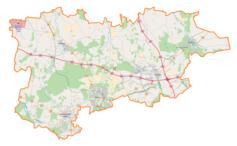 """Mapa konturowa powiatu zgierskiego, po lewej znajduje się punkt z opisem """"Grotniki"""""""