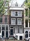 foto van Huis waarvoor gevel onder rechte lijst met dakkapel