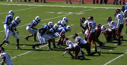 "In the traditional or ""cup"" punt formation, the long snapper is the center of the interior line (#58 in blue) Punt block formation.jpg"