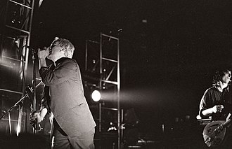 R.E.M. - Michael Stipe (left) and Peter Buck (right) on stage in Ghent, Belgium, during R.E.M.'s 1985 tour.