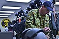RAAF airman performs maintenance on a pilot's helmet in 2013.jpg