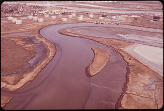 Rahway River - 1973 photo of the Rahway River looking towards the Arthur Kill. Potters Island is in the center. The site of the 2016 Rahway Arch project curves into the Rahway in the upper right of the photo, directly above Potters Island. Marshes Creek enters the Rahway on the lower left, and the site of the 2016 Tremley Point Road project is to the left of Potters Island in the photo