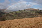 Rainbow over Gaer Viewed from the slopes of Bryn Arw.