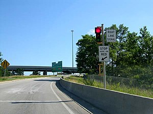 Traffic engineering (transportation) - A ramp meter limits the rate at which vehicles can enter the freeway