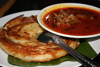 Curry - Kari kambing (mutton curry) served with roti canai in Sumatra.