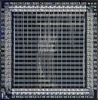 Application-specific integrated circuit - Microscope photograph of a gate-array ASIC showing the predefined logic cells and custom interconnections. This particular design uses less than 20% of available logic gates.
