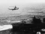 SH-3A of HS-2 lowers torpedo on USS Parsons (DDG-33) in April 1969.jpg