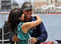 Sailor hugs girlfriend before deployment. (9400960365).jpg