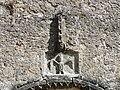 Saint-Geyrac église décor au-dessus portail.JPG