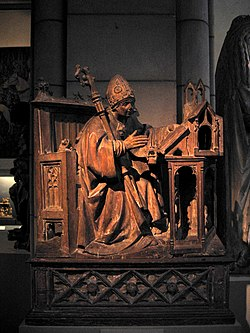 Saint Ambrose in His Study, ca. 1500. Spanish, Palencia. Wood with traces of polychromy. Metropolitan Museum of Art, New York City.
