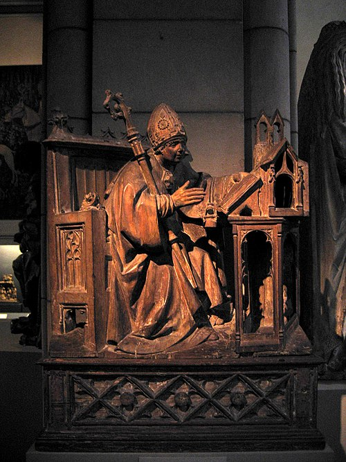 Saint Ambrose in His Study, c. 1500. Spanish, Palencia. Wood with traces of polychromy. Metropolitan Museum of Art, New York City. Saint Ambrose in His Study 1.jpg