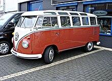 A Red Volkswagen Samba Bus 23 Windows
