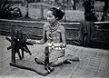 Sarawak; a native girl spinning cotton into thread. Photogra Wellcome V0037416ER.jpg
