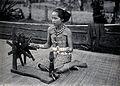 Sarawak; a native girl spinning cotton into thread. Photogra Wellcome V0037416ER.jpg