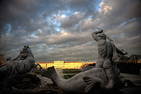 Schönbrunn Palace (Visitor's entrance to Imperial rooms) as seen from the point of Neptune Fountain, right through Great Parterre. Vienna, Austria, Western Europe.jpg
