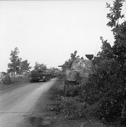 Irish Guards Sherman tanks advance past knocked out Shermans, 17 September 1944 Sherman tanks of the Irish Guards Group.jpg