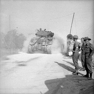 Sherman Firefly - A Sherman Firefly crosses 'Euston Bridge' over the Orne as it moves up to the start line for Operation Goodwood, 18 July 1944