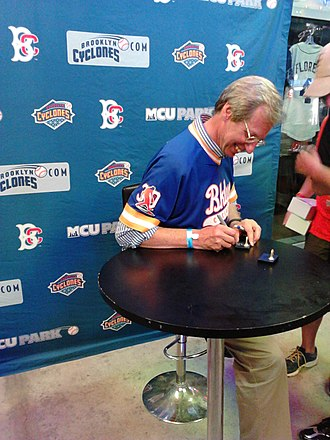 Sidd Finch - Joe Berton autographs a Sidd Finch bobblehead at Brooklyn Cyclones game. Note special anniversary logo on the jersey sleeve.