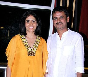 Sonali Kulkarni - Indian film actors Sonali and Girish at the 14th Mumbai Film Festival