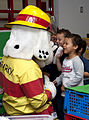 Sparky the fire dog visits children at Joint Base Langley-Eustis, Va., during Fire Prevention Week hosted by the 633rd Civil Engineer Squadron Oct. 10, 2013 131010-F-IT851-008.jpg