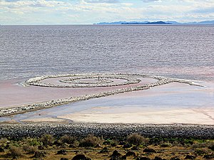 Spiral Jetty - Person standing in the middle of Spiral Jetty, viewed from the shore