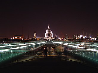 Millennium Bridge, London - London Millennium Bridge at night.  This image shows the well known and much photographed illusion of St. Paul's Cathedral being supported by one of the bridge supports.