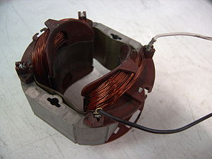 Electromagnetic coil - Field coil electromagnet on the stator of an AC universal motor.