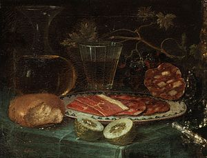 Ham sausage - Still life with ham platter. Italo-Flemish, 17th century. Slices of ham sausage are on the right.