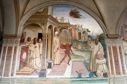 Il Sodoma, Le storie di San Benedetto Scena 13 - Come Benedetto libera uno monaco indemoniato percuotendolo