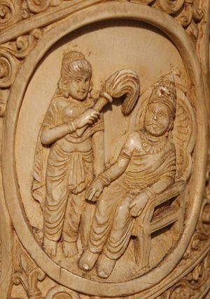 Śuddhodana - Image: Suddhodna seated on a throne Roundel 2 ivory tusk