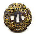 Sword guard by Naomasa, Edo period, 17th century, family crests design in openwork - Tokyo National Museum - DSC05215.JPG