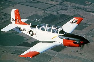 Beechcraft T-34 Mentor - A T-34C Turbo-Mentor, which can be distinguished from the B (piston) model by the extended nose and exhaust stacks on either side behind the prop to accommodate the jet turboprop engine