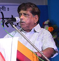 Tapodhir Bhattacharjee speaking during Language Martyr Day meeting at Silchar station in 2018 10 (cropped).jpg