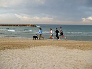 Jogging on the beach early morning in Tel Aviv, Israel.