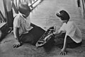 Thai-girls-playing-with-mancala-board-possibly-main-chakot-or-mak-khom.jpg
