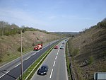 A two-lane dual carriageway in a cutting.