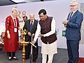 The Minister of State for Agriculture and Farmers Welfare, Shri Sudarshan Bhagat lighting the lamp at the celebration to mark the 50th anniversary of the release of the rice variety, IR8, in New Delhi.jpg