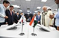 The Prime Minister, Shri Narendra Modi and the President of the Republic of South Korea, Mr. Moon Jae-in taking a tour of World's Largest Mobile Factory, in Noida, Uttar Pradesh on July 09, 2018.JPG