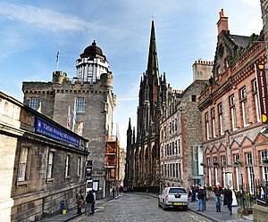 Royal Mile - Castlehill forming part of the Royal Mile. The former Victorian church houses The Hub, an information service for the Edinburgh International Festival. On the right is The Scotch Whisky Experience and on the left the Camera Obscura tower and shops.