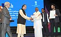 The Union Minister for Finance, Corporate Affairs and Information & Broadcasting, Shri Arun Jaitley presents the centenary award to Music Maestro Ilayaraja.jpg