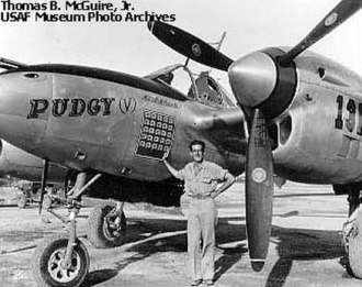"53d Weapons Evaluation Group - Major Thomas McGuire of the 431st Fighter Squadron next to his Lockheed P-38J ""Pudgy (V)"" (44-24155)"