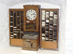 Time clock - Early time clock, made by National Time Recorder Co. Ltd. of Blackfriars, London at Wookey Hole Caves museum.