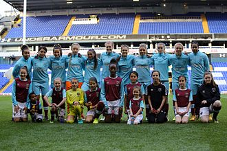West Ham United F.C. Women - West Ham team with their player escorts in April 2017 prior to a match against Tottenham Hotspur at White Hart Lane.
